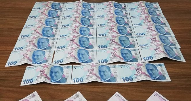Mahalle bekçileri sahte parayla alışveriş yapan şahısları yakaladı